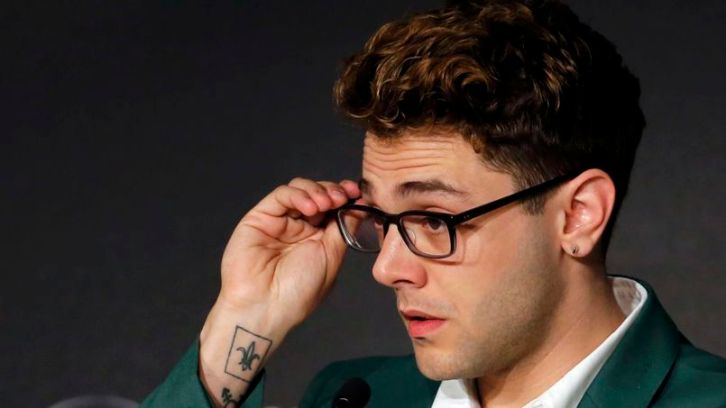 """Director Xavier Dolan attends a news conference for the film """"Mommy"""" in competition at the 67th Cannes Film Festival in Cannes"""