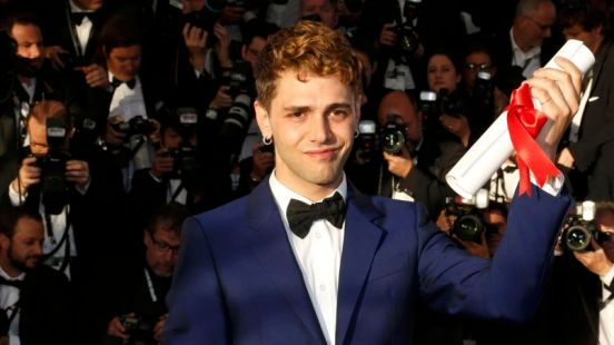 """Director Xavier Dolan, Jury Prize award winner for his film """"Mommy"""", poses during a photocall at the closing ceremony of the 67th Cannes Film Festival in Cannes"""