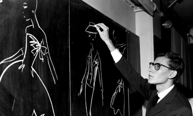 Yves Saint-Laurent Sketching On Chalkboard